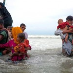 On 7 September 2017, newly arrived Rohingya refugees walk ashore