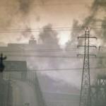 DARK_CLOUDS_OF_FACTORY_SMOKE_OBSCURE_CLARK_AVENUE_BRIDGE_-_NARA_-_550179.resized