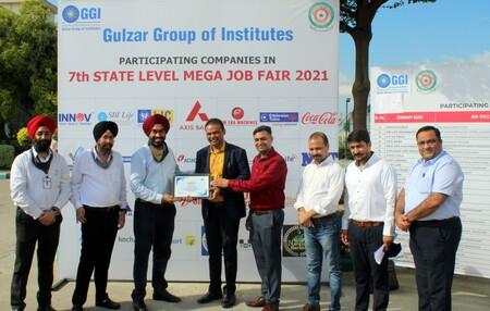 MLA Gurkirat Singh Kotli talking to company representatives at an employment fair organized at Gulzar Group of Institutes 9 copy.resized